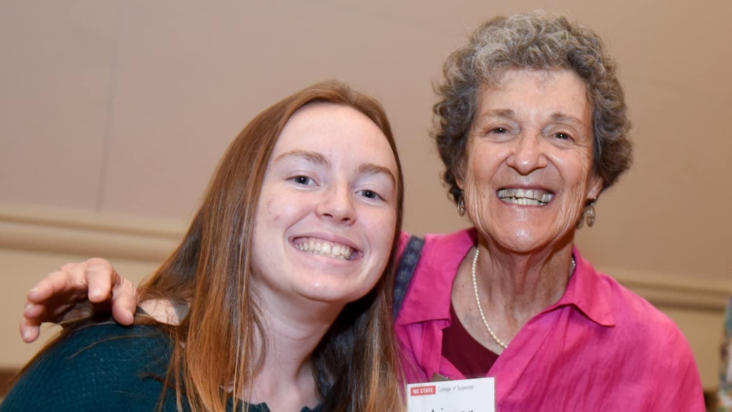 Donor Aimee Tattersall smiles with a student